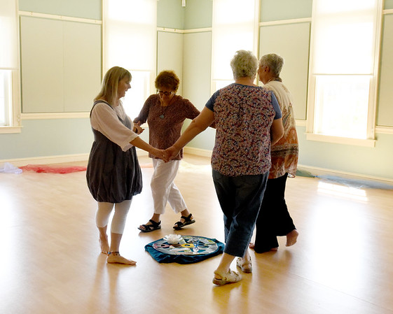 "BRYAN EATON/Staff photo. Dance instructor Ellen Kennedy, left, leads people in dance, with more joining when the camera was put away, at the Newburyport Senior Center. Her ""Sacred Circle Tradition"" helps to increase balance, flexibility and relaxation."