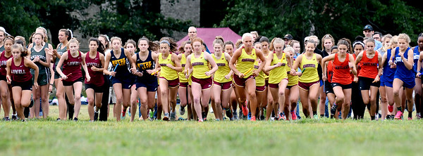 JIM VAIKNORAS/Staff photo Girls take off at the start of  the Clipper Relay at Maudslay State Park Saturday.