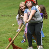 JIM VAIKNORAS/Staff photo Chloe Roberge, 11, competes in the tug of war Saturday at the Amesbury 250th Town Picnic at Amesbury Town Park.