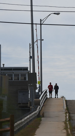 JIM VAIKNORAS/Staff photo A couple takes an early morning stroll over the Gillis Bridge Saturday.