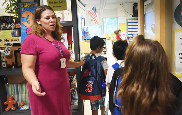 BRYAN EATON/Staff photo. Third grade teacher Bethany Marshall greets students as they enter the classroom on Tuesday morning at Salisbury Elementary School. It was the first day of classes in the Triton Regional District.