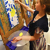 BRYAN EATON/Staff photo. Olivia Bugli, 6, paints a sunflower surrounded by blue sky at the Bresnahan School in Newburyport. The first-graders in Pamela Standley-Jamison's art class were being introduced to the style and subject matter of Vincent van Gogh.