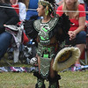 JIM VAIKNORAS/Staff photo Tlazo dances with the Kalpulli Huehuetllolli Aztec during the annual Inter-Tribal Pow Wow at Plug Pond in Haverhill Saturday.
