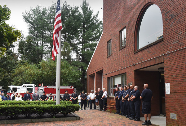 BRYAN EATON/Staff photo. With the American flag at half staff, members of the Newburyport police and fire departments, with members of the community, remembered those who perished in the 9/11 attacks of 2001.