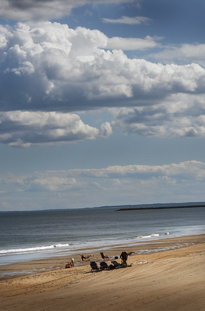 BRYAN EATON/Staff Photo. Several people were enjoying the extended summer weather at Salisbury Beach as clouds appeared on Tuesday afternoon. The rest of the week and into the weekend will have nice weather with a chance of showers on Thursday night.