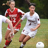 BRYAN EATON/Staff Photo. Amesbury's Mary Kate McElaney and Deirdre McElhinney chase the ball.