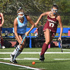 BRYAN EATON/Staff Photo. Triton's Gianna Conte and Martina Justiano chase the ball.