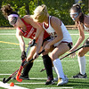 BRYAN EATON/Staff Photo. Amesbury's Brianna Morel and Newburyport's Emily  Fuller battle for the ball.