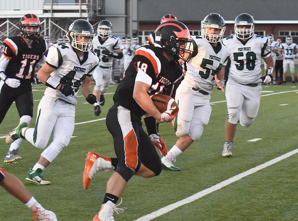 BRYAN EATON/Staff photo. Ipswich running back Cole Terry makes some gains as Pentucket defenders move in.