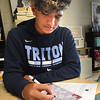BRYAN EATON/Staff Photo. Triton freshman Noah Tillman, 15, along with students in the rest of the high and middle school penned letters to veterans as part of the 9/11 National Day of Service.