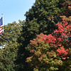 BRYAN EATON/Staff Photo. Patritotic colors are visible along with some fall colors as leaves begin to change on the Bartlett Mall in Newburyport. Fall does arrive next Monday on the 23rd, later than usual.