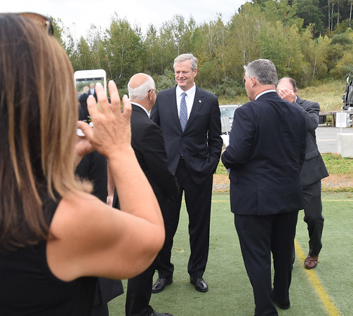 BRYAN EATON/Staff photo. Governor Charlie Baker meets with Mayor Ken Gray and officials from the Maples Crossing sports complex before the groundbreaking ceremony.