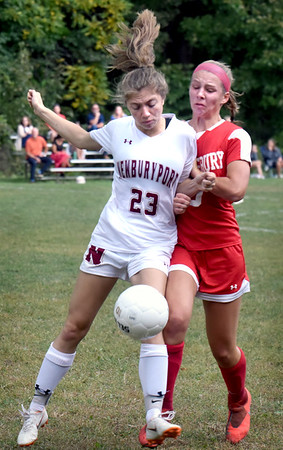 BRYAN EATON/Staff Photo. The Clippers' Kelsey Soule and Alyssa Pettet collide going for the ball.