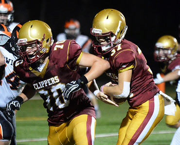CARL RUSSO/staff photo. With a block from Newburyport's Eamonn Sullivan, Jason Tamayoshi finds running room. Newburyport's Newburyport high vs. Ipswich high in Friday night football action. 9/20/2019