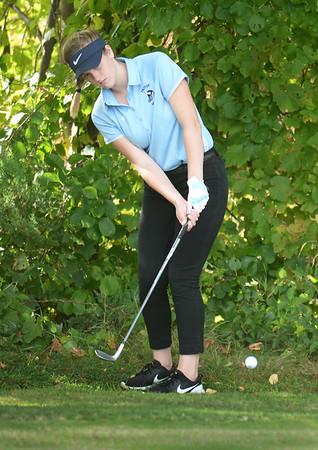 BRYAN EATON/Staff Photo. Triton senior Caitlin White putts the ball back onto the green.