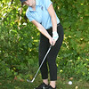 BRYAN EATON/Staff Photo. Triton senior Caitlin White putts the ball back onto the green.