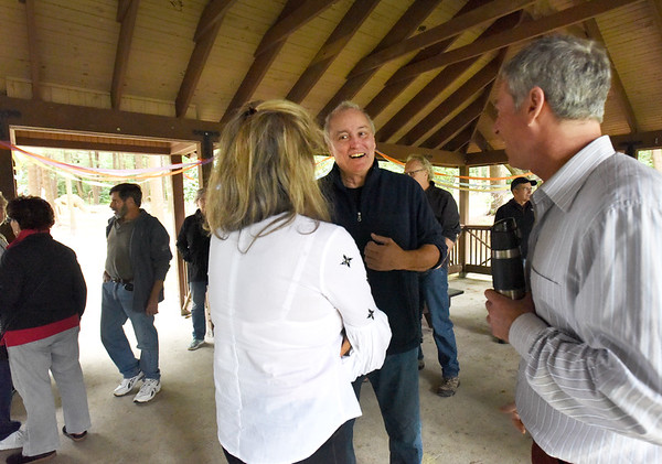BRYAN EATON/Staff photo. Greg Earls greets people at the open air lodge at Moseley Woods on Friday night. The Newburyport city councilor is stepping down as he is moving out of town.