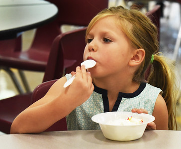 BRYAN EATON/Staff Photo. Moriah Sousa, 6, enjoys every bit of her ice cream, whipped cream and gummy bears with colored jimmies at Newbury Elementary School. Those who completed their summer math packets were treated to an ice cream social courtesy of the PTA with the ice cream donated by Hodgie's Too of Newburyport.