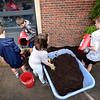 BRYAN EATON/Staff Photo. Amesbury Middle School students spread mulch after pulling weed in the school's courtyard as part as a kickoff event for the new Parent Advisory Group and Care Program.