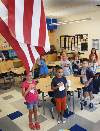 BRYAN EATON/Staff Photo. Second-graders in Sue Westgate's class at the Bresnahan School cite the Pledge of Allegiance on Thursday morning. Newburyport was the last of the area's public schools to begin classes for the school year.