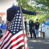 BRYAN EATON/Staff Photo. Veterans Agent Kevin Hunt gestures to William Shuttleworth at a gathering in Brown Square in front of Newburyport City Hall.