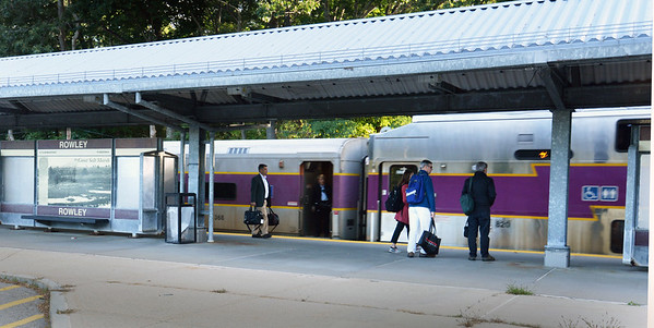 BRYAN EATON/Staff Photo. The Newburyport commuter rail picks up passengers at the Rowley Station on Monday morning. The station had been closed because of a suspicious item which a bomb squad found to be an empty pressure cooker left on a bench.
