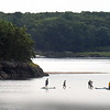 BRYAN EATON/Staff photo. People on various water watercraft check out the sandbar in the Merrimack River off Eagle Island to the left on Monday morning. Photo was taken from near the Hines Bridge.
