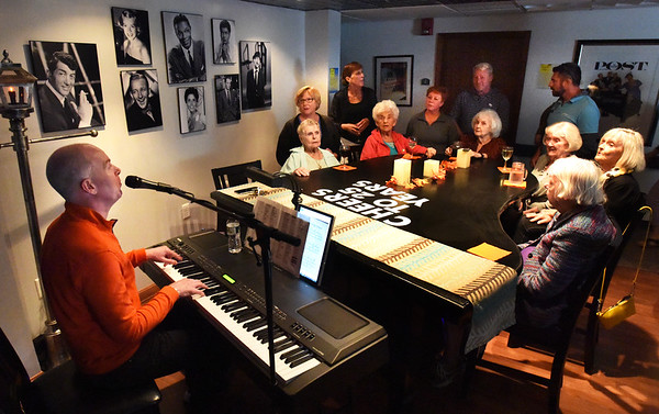BRYAN EATON/Staff Photo. Pianist Jason Weber entertains residents and staff of the Salisbury Assisted Living Center on Tuesday during at the Cabaret Piano Bar. The event is one of several the facility is hosting this week including a Seafood Festival to celebrate their 25th year.