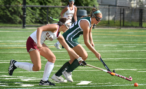 BRYAN EATON/Staff Photo. Callie Beauparlant races for the ball with Pentucket's Talia Beech.
