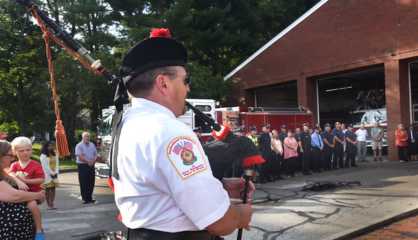 """BRYAN EATON/Staff Photo. Newburyport firefighter Bob Morse plays """"Amazing Grace"""" at the conclusion of 9/11 rememberance ceremony at the Newburyport Fire Station."""