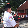 "BRYAN EATON/Staff Photo. Newburyport firefighter Bob Morse plays ""Amazing Grace"" at the conclusion of 9/11 rememberance ceremony at the Newburyport Fire Station."