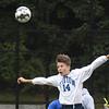 BRYAN EATON/Staff Photo. Triton's Josh Monroe knocks the ball toward the Georgetown goal.