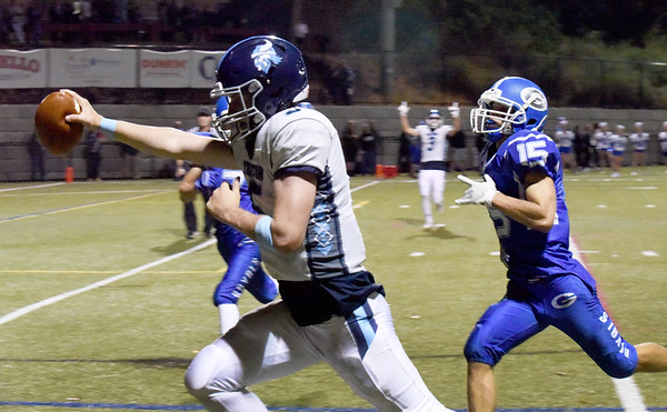 BRYAN EATON/Staff photo. Triton quarterback Kyle Odoy holds the ball as he crosses the end zone for his team's second touchdown.