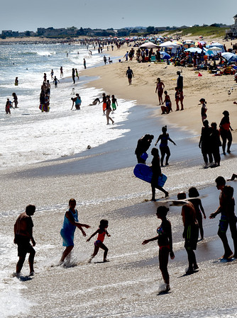BRYAN EATON/Staff Photo. People frolic in the surf at Salisbury Beach on the start of the Labor Day Weekend on Friday, with the weather expected to be nice for the most part with rain possible late Sunday and into Monday. It remains to be seen what effect Hurrican Dorian will have on the surf next week, though some expect strong waves from the storm.