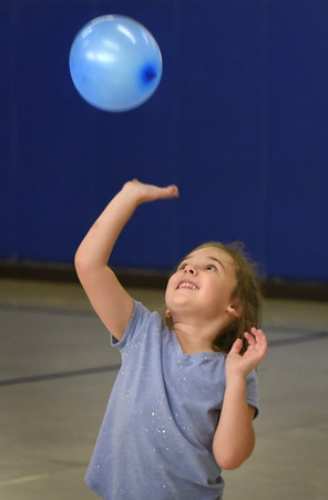 BRYAN EATON/Staff Photo. Kendyl Hildonen, 5, bats a balloon around with classmates in Margaret Welch's physical education class. The youngsters were working on eye to hand coordination, balance and spacial awareness.