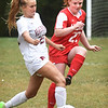 BRYAN EATON/Staff Photo. Matigan DeFeo and Riley Doherty scramble for the ball.