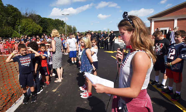 """BRYAN EATON/Staff Photo. Pine Grove School sixth-grader Isabella Carmody, who turns 12 tomorrow, spoke about the tradgedy of the 9/11 terrorist attacks and how it brought unity and hope to the country. The Rowley School students then sang """"The Star-Spangled Banner"""" at the conclusion of the short ceremony."""