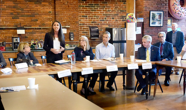 BRYAN EATON/Staff Photo. State Sen. Diana DiZoglo, standing, welcomes fellow senators to the CI Works facility in Amesbury on Tuesday morning.