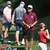 BRYAN EATON/Staff Photo. Newburyport High School golf coach Bill Pettingell with his team at practice at Rowley Country Club.