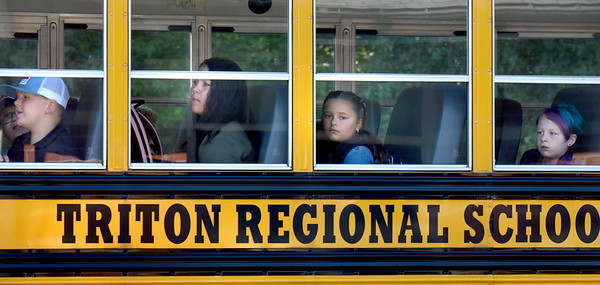 BRYAN EATON/Staff Photo. Students wear looks of aprehension or anticipation as they pull into the driveway of the Salisbury Elementary School on Tuesday morning. It was the first day of classes for the Triton Schooll District which includes the towns of Newbury and Rowley.