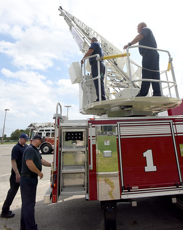 BRYAN EATON/Staff Photo. A crew from the Newburyport Fire Department try out the new ladder truck the city purchased as the become acquainted with its operation at Cashman Park. The truck replaces one that was 20 years old and will remain as a back up unit.