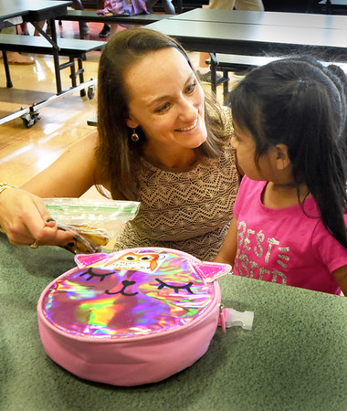 BRYAN EATON/Staff Photo.  Cashman School principal Karina Mascia Fayles engages kindergartner Dayana Aguilar, 5, during lunch on Wednesday. She's starting her second year as the Amesbury School's principal.
