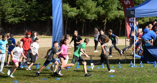 BRYAN EATON/Staff Photo. Salisbury Elementary School students on their Fun Run which ran for two hours, divided by the six different grade levels.