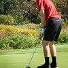 BRYAN EATON/Staff Photo. Amesbury's Bryce Jackson putts on the first green.