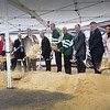BRYAN EATON/Staff photo. Wearing green hockey jerseys and flanked by public officials and developers of the Maples Crossing sports complex, Gov. Charlie Baker and Amesbury Mayor Ken Gray lead a groundbreaking.