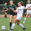 BRYAN EATON/Staff Photo. Cricket Good kicks the ball past Pentucket's Sarah Riter.