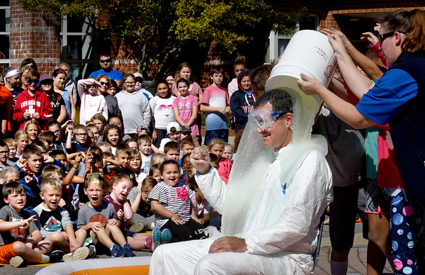 """BRYAN EATON/Staff Photo. Salisbury Elementary School principal Jim Montanari got """"slimed"""" by students from each grade for a promise he made. The school's PTA held a Fun Run to raise money for enrichment programs with Montanari promising to get slimed if they met the goal. They fell slightly short, but he felt their effort and attitude rose to the occasion that they deserved a little fun at his expense."""
