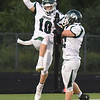 BRYAN EATON/Staff photo. Pentucket gets on the scoreboard with a touchdown by Jake Etter (#10).
