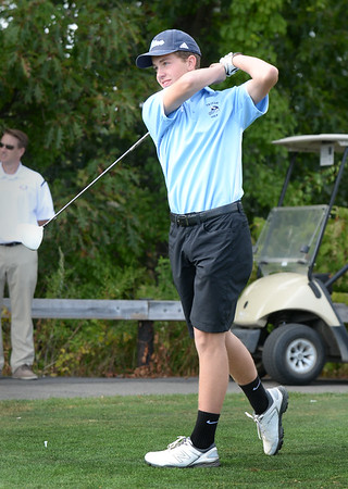 BRYAN EATON/Staff Photo. Triton's Nick RItchie on the follow through as he tees off.
