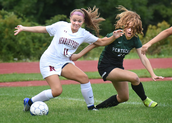 BRYAN EATON/Staff Photo. Newburyport's Cricket Good and Katelyn Sudbay shift to follow a loose ball.